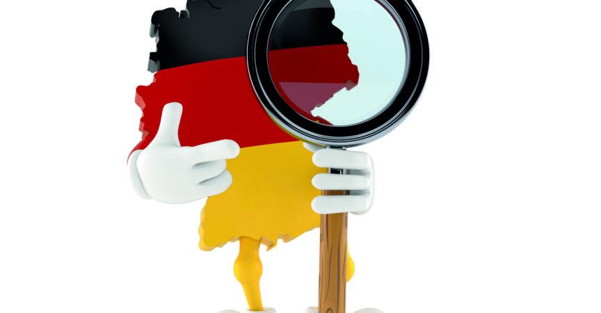 Deutsches Zeichen mit Lupe lokalisiert auf weißem Hintergrund. 3D-Illustration