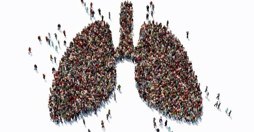 Menschliche Menge, die ein großes Lungensymbol bildet