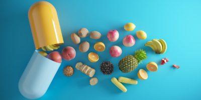 Eine öffnende Kapsel und durch Lebensmittel, Früchte kommen. (3d rendern)
