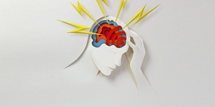 Paper cutout of someone with headache,conceptual illustration.
