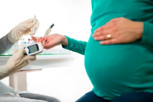 Pregnant Woman Having Blood Glucose Checked