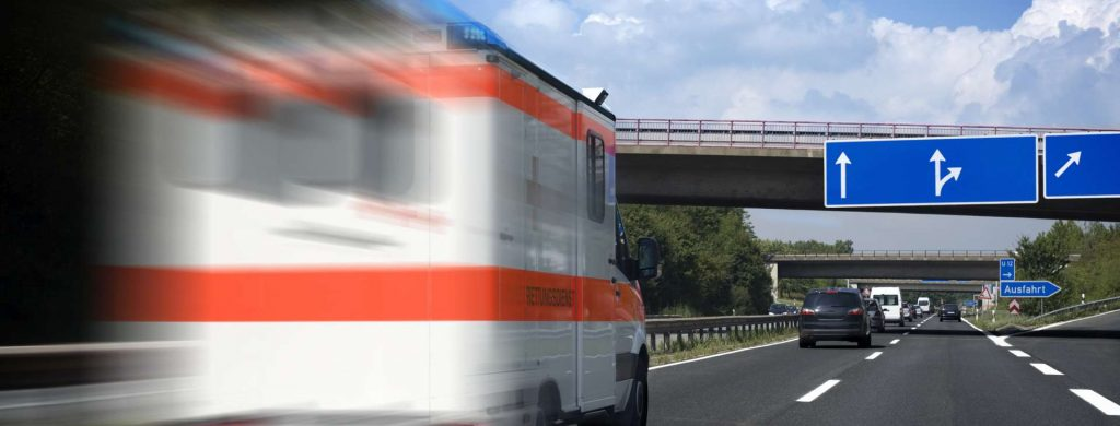 """Speeding German ambulance on the highway, motion blur, all identificable logos and numbers have been removed carefully. The german word """"Rettungsdienst"""" means """"Ambulance"""""""
